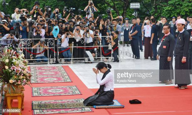 Myanmar leader Aung San Suu Kyi attends a ceremony at the Martyrs' Mausoleum in Yangon on July 19 to observe the 70th anniversary of Martyrs' Day...