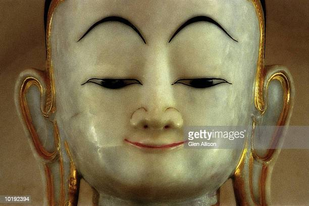 Myanmar, Maha Aung Mye Bon Zan Monastery, close-up of buddha's face