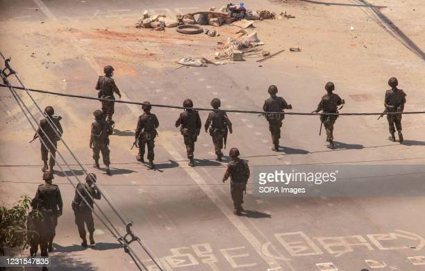 Myanmar military are seen advancing towards the protesters with weapons during a demonstration against the military coup. Myanmar police attacked...