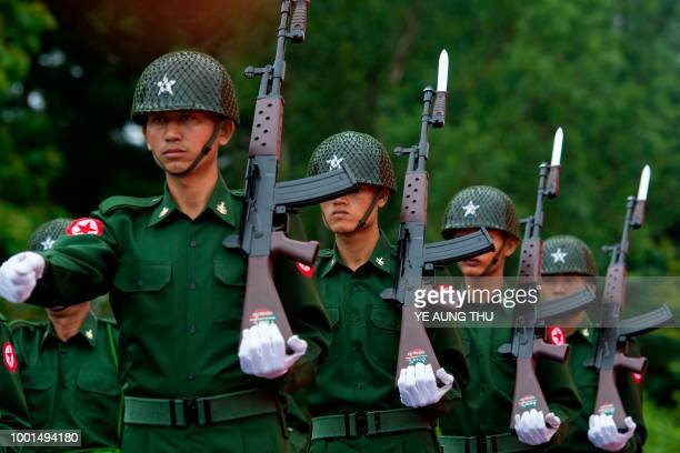 A Myanmar military guard of honour marches during a ceremony to mark the 71th anniversary of Martyrs' Day in Yangon on July 19 2018 Myanmar observes...