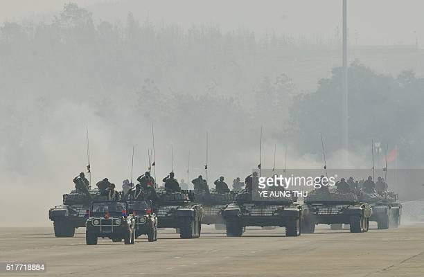 Myanmar military tanks are paraded during a ceremony to mark the 71st Armed Forces Day in Myanmar's capital Naypyidaw on March 27 2016 / AFP / YE...