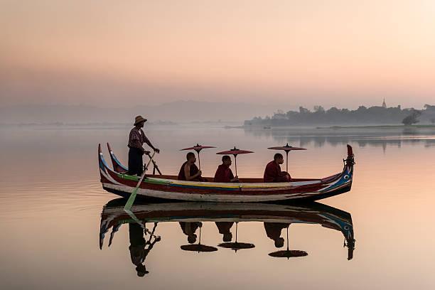 Myanmar, monks in boat at Ubein Bridge