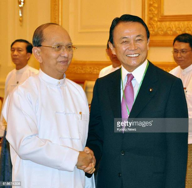 Myanmar - Myanmar President Thein Sein and Japanese Deputy Prime Minister and Finance Minister Taro Aso shake hands prior to their talks in Naypyitaw...
