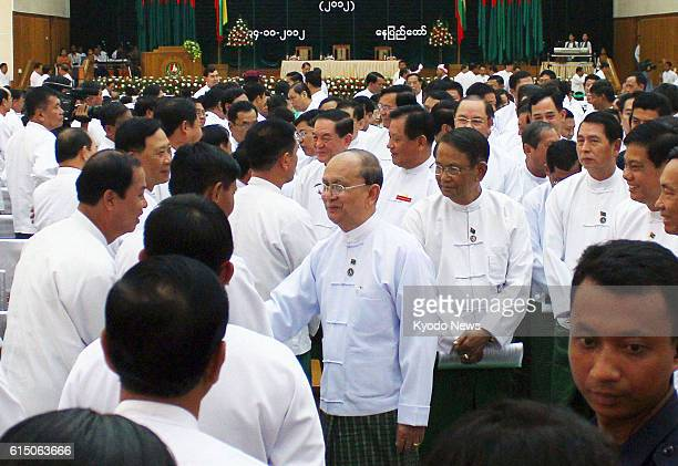 Myanmar - Myanmar President Thein Sein greets members of Myanmar's ruling Union Solidarity and Development Party during the party assembly in...