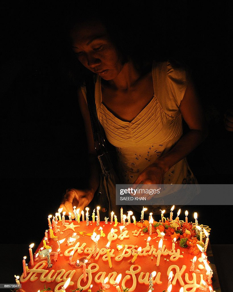 Tremendous A Myanmar National Places A Candle On The 64Th Birthday Cake Of Personalised Birthday Cards Veneteletsinfo