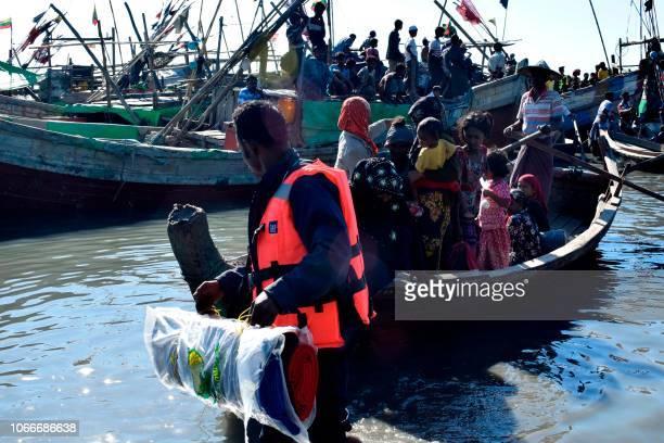 Myanmar Navy personnel escort Rohingya Muslims back to their camp in Sittwe Rakhine state on November 30 2018 Nearly 100 Rohingya Muslims were forced...