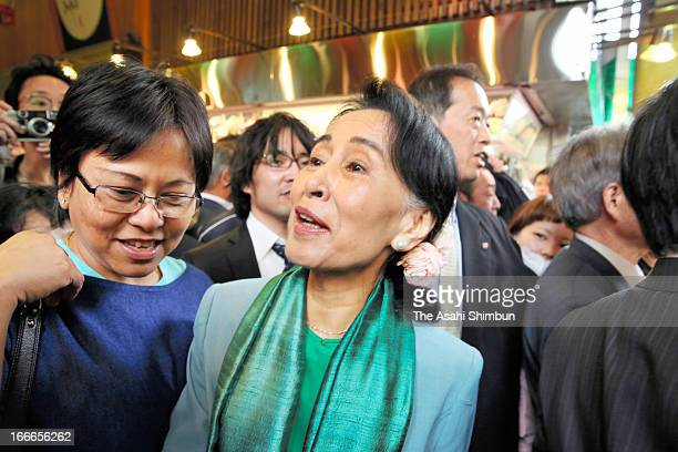 Myanmar opposition democratic leader Aung San Suu Kyi visits Kyoto's Nishiki Market on April 14 2013 in Kyoto Japan Aung San Suu Kyi is on 7day visit...