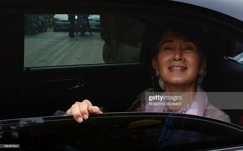 Myanmar opposition leader and National League for Democracy Chairperson Aung San Suu Kyi smiles as she looks from the window of a car following a function at a school in New Delhi on November 16, 2012. The Nobel laureate, on a visit to neighbouring India and who is now a member of parliament after dramatic changes overseen by a quasi-civilian regime that took power last year, was released from military house arrest in 2010. AFP PHOTO/Roberto Schmidt