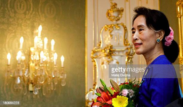 Myanmar opposition leader and Nobel Peace Prize laureate Aung San Suu Kyi is welcomed by Czech President Milos Zeman at Prague Castle on September...