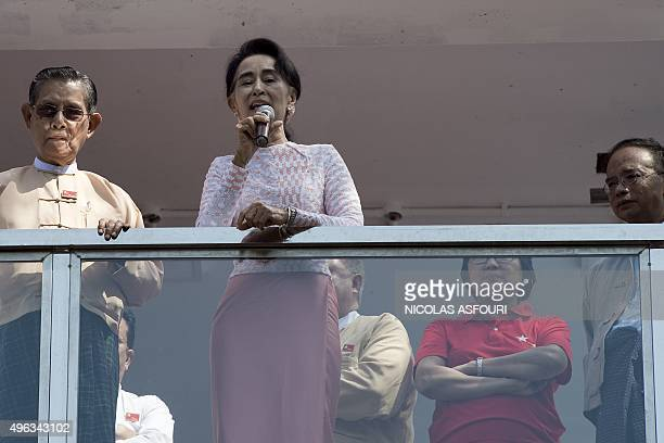 Myanmar opposition leader Aung San Suu Kyi delivers a speech from the balcony of the National League of Democracy headquarters in Yangon on November...