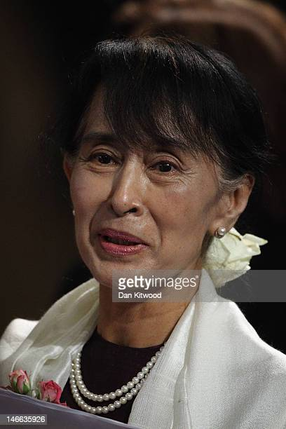 Myanmar opposition leader Aung San Suu Kyi leaves Westminster Hall after addressing both Houses of Parliament on June 21 2012 in London England The...