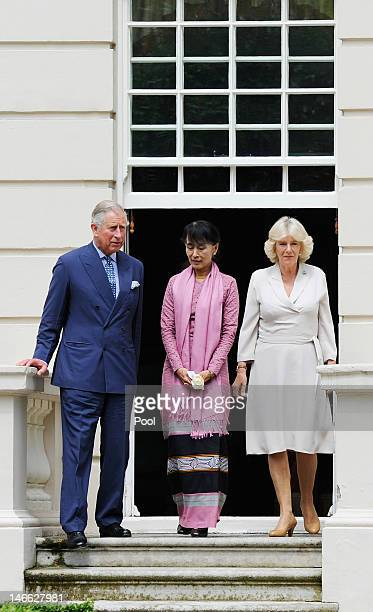Myanmar opposition leader Aung San Suu Kyi meets with Prince Charles Prince of Wales and Camilla Duchess of Cornwall before planting a Magnolia tree...