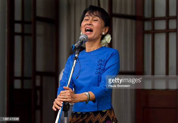 Myanmar opposition leader Aung San Suu Kyi speaks to the media outside her residence after talks with Tomas Ojea Quintana, the UN's Special human...