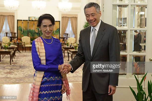 Myanmar opposition leader Daw Aung San Suu Kyi meets with Singapore Prime Minister Lee Hsien Loong at the Istana on September 23 2013 in Singapore...