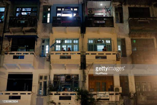 Myanmar people take part in a protest against military coup from their apartment building near Sule Pagoda at downtown area in Yangon, Myanmar on...