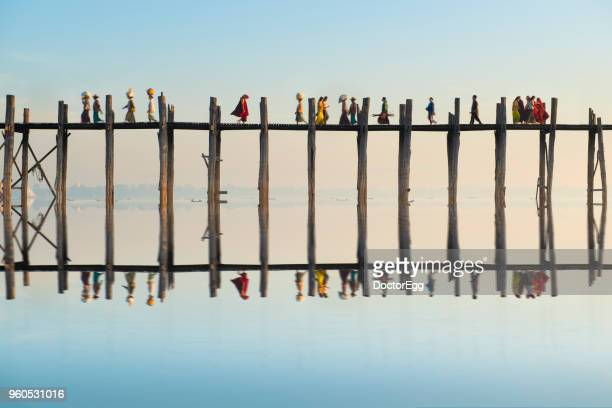 myanmar people walking across u bein bridge in morning, mandalay, myanmar - ミャンマー ストックフォトと画像