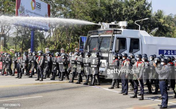 Myanmar police fire water cannon at protesters as they continue to demonstrate against the February 1 military coup in the capital Naypyidaw on...