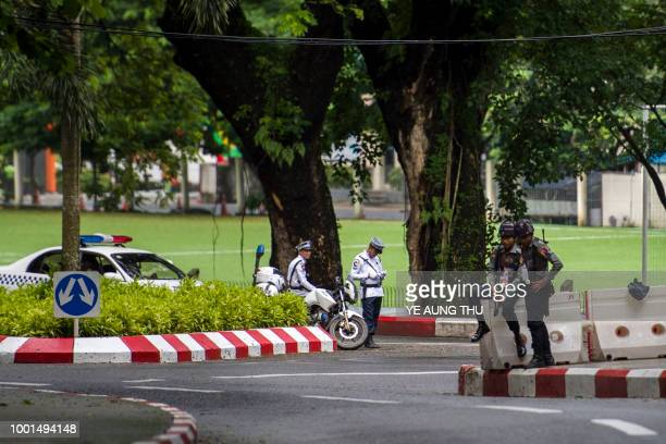 Myanmar police stand guard on the street as the country marks the 71th anniversary of Martyrs' Day in Yangon on July 19 2018 Myanmar observes the...
