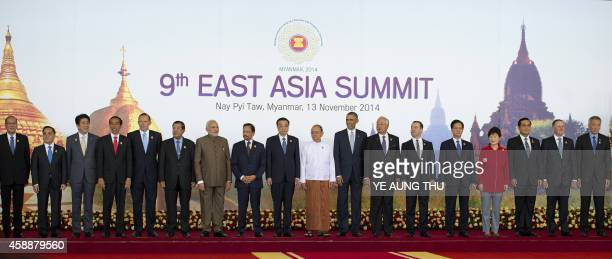Myanmar President Thein Sein stands next to US President Barack Obama and China's Prime Minister Li Keqiang and other leaders as they pose for a...