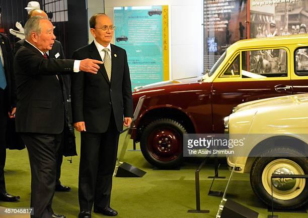 Myanmar Prime Minister Thein Sein listens to the explanation of Suzuki Motor Co Chairman Osamu Suzuki at Suzuki's factory on December 15, 2013 in...