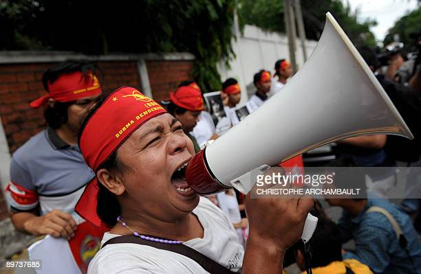 A Myanmar prodemocracy activist shouts slogans using a megaphone during a protest in support of detained opposition leader Aung San Suu Kyi outside...