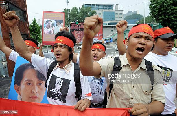 Myanmar pro-democracy activists chant slogans during a rally against the country's military junta near the Myanmar embassy in Seoul on July 7, 2009....