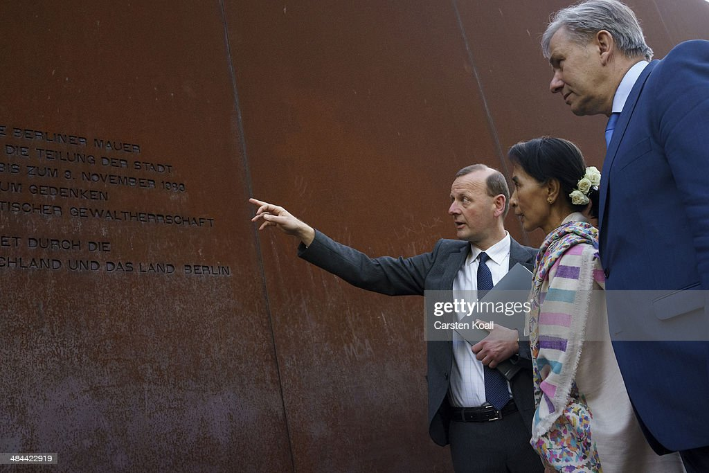 Myanmar pro-democracy leader Aung San Suu Kyi (C), Director of the Berlin Wall Memorial Axel Klausmeier (L) and Berlin's Mayor Klaus Wowereit (R) chat during a visit to the Berlin Wall Memorial on April 12, 2014 in Berlin, Germany. Myanmar's opposition leader and Nobel laureate Aung San Suu Kyi visits Germany for some days.