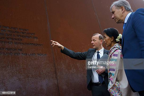 Myanmar prodemocracy leader Aung San Suu Kyi Director of the Berlin Wall Memorial Axel Klausmeier and Berlin's Mayor Klaus Wowereit chat during a...