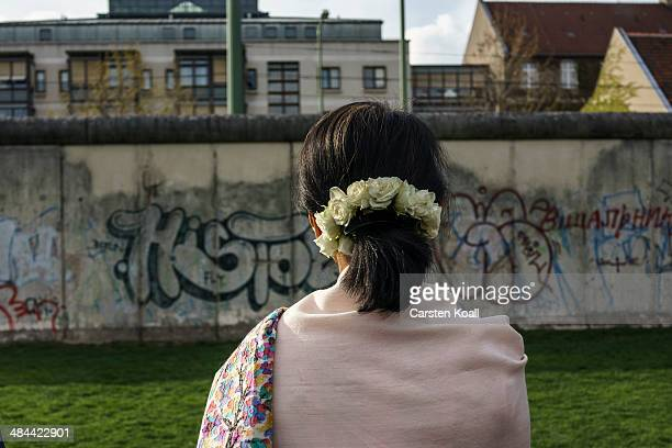 Myanmar prodemocracy leader Aung San Suu Kyi stays in front of the wall backside during a visit to the Berlin Wall Memorial on April 12 2014 in...
