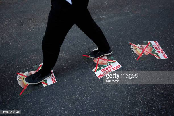 Myanmar protester tramples the pictures of Military junta chief General Min Aung Hlaing with his face crossed during a demonstration against the...