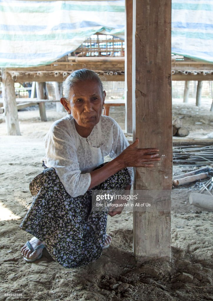 Myanmar, Rakhine state, Thandwe, rohingya woman showing the pillar of her house cut by 969 extremists buddhists