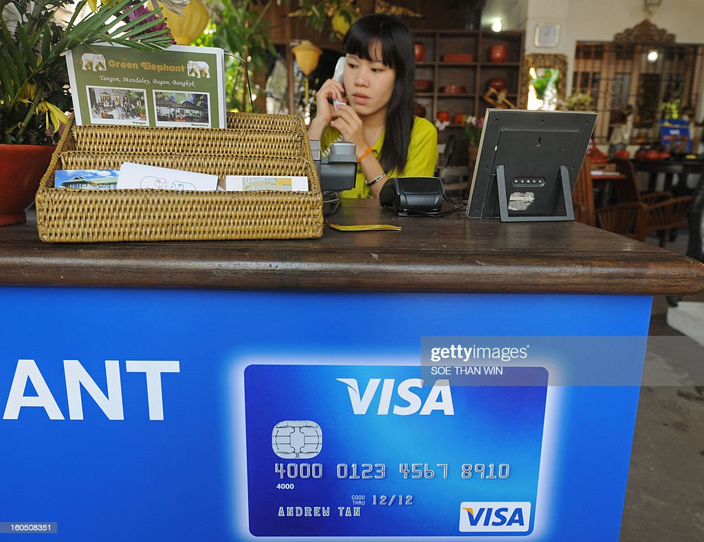 A Myanmar receptanist works at a restaurant which accepts Visa electronic payment following the US credit card giant Visa's launch in Myanmar, marking the long-awaited debut of plastic in a country...