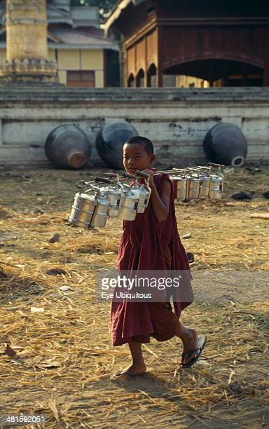 Myanmar Religion Buddhism Young Monk carrying Tiffin Boxes over his shoulder