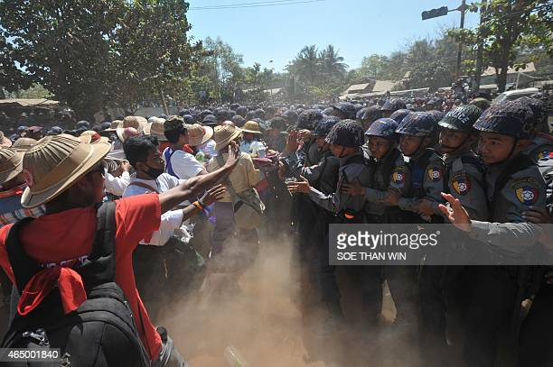 Myanmar riot police confront students during a protest march in Letpadan town, some 130 kilometres north of Myanmar's main city Yangon on March 3,...