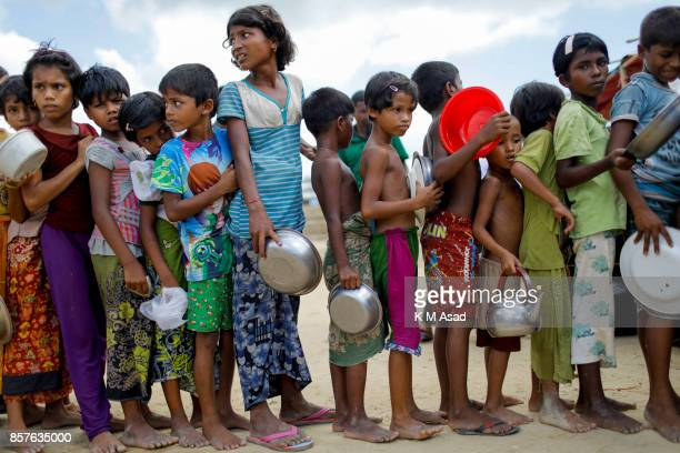 Myanmar Rohingya refugees children wait to collect food a refugee camp in Ukhiya Cox's Bazar According to the UNHCR more than 500000 Rohingya...