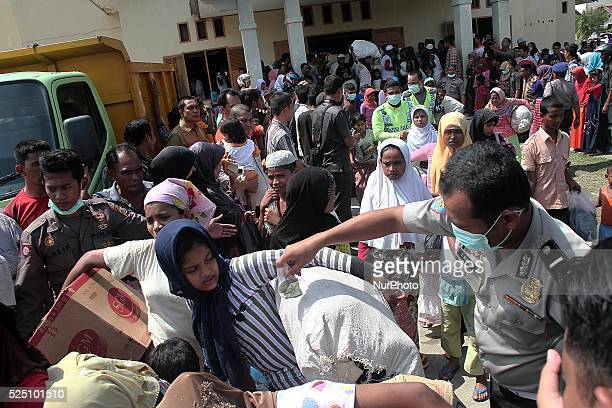 Myanmar Rohingya women assisted the Indonesian police to be moved from temporary shelters in Lhoksukon Aceh province Indonesia on 13 May 2015 after...