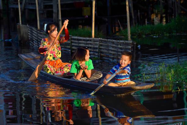 Myanmar, Shan State, Inle Lake, Kay Lar village, Happy family