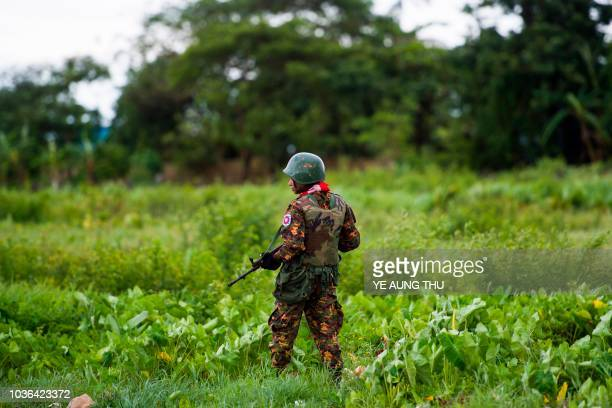 A Myanmar soldier guards an area at the Sittwe airport as British foreign minister Jeremy Hunt arrives in Sittwe Rakhine state on September 20 2018...