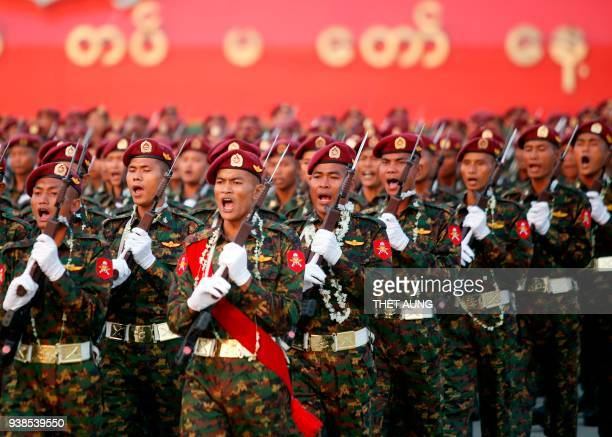 Myanmar soldiers march in formation during a military parade in Naypyidaw on March 27, 2018 to mark the 73rd Armed Forces Day. / AFP PHOTO / Thet AUNG