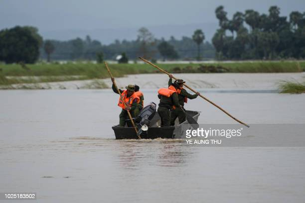 Myanmar soldiers steer a boat to reach a flooddamaged area in Swar town of Bago region on August 30 2018 A largescale rescue effort marches on into a...