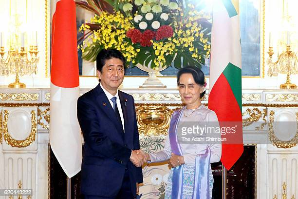 Myanmar State Counsellor and Foreign Minister Aung San Suu Kyi and Japanese Prime Minister Shinzo Abe shake hands prior to their meeting at the...