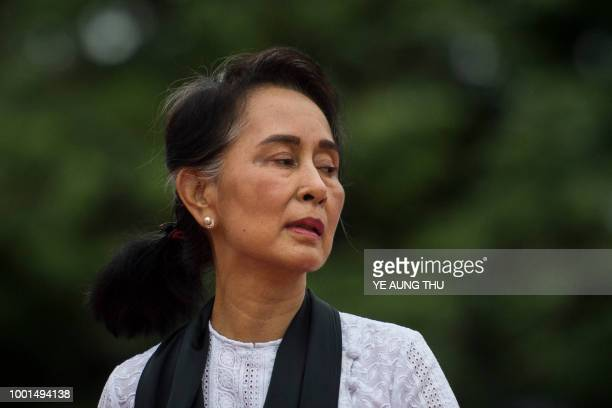 Myanmar State Counsellor and Foreign Minister Aung San Suu Kyi leaves after paying her respects to her late father during a ceremony to mark the 71th...