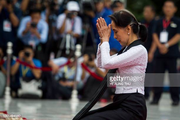 TOPSHOT Myanmar State Counsellor and Foreign Minister Aung San Suu Kyi pays her respects to her late father during a ceremony to mark the 71th...