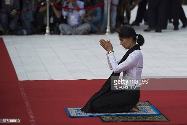 TOPSHOT Myanmar State Counsellor and Foreign Minister Aung San Suu Kyi pays her respects to her late father Myanmar independence hero General Aung...