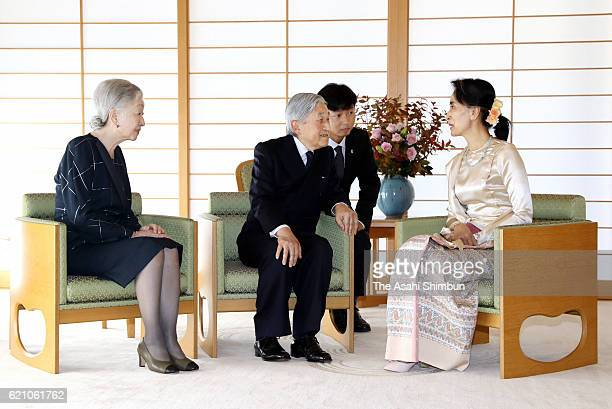 Myanmar State Counsellor and Foreign Minister Aung San Suu Kyi talks with Emperor Akihito and Empress Michiko during their meeting at the Imperial...