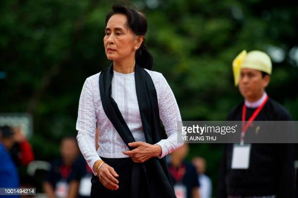 Myanmar State Counsellor and Foreign Minister Aung San Suu Kyi arrives to pay her respects to her late father during a ceremony to mark the 71th...