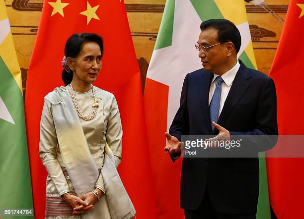 Myanmar State Counsellor Aung San Suu Kyi and Chinese Premier Li Keqiang talk during a signing of agreements ceremony at the Great Hall of the People...