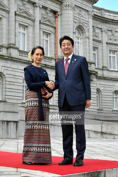 Myanmar State Counsellor Aung San Suu Kyi and Japanese Prime Minister Shinzo Abe shake hands during the welcome ceremony prior to the Mekong-Japan...