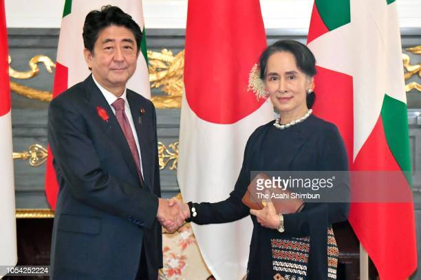 Myanmar State Counsellor Aung San Suu Kyi and Japanese Prime Minister Shinzo Abe shake hands prior to their bilateral meeting on the sidelines of the...