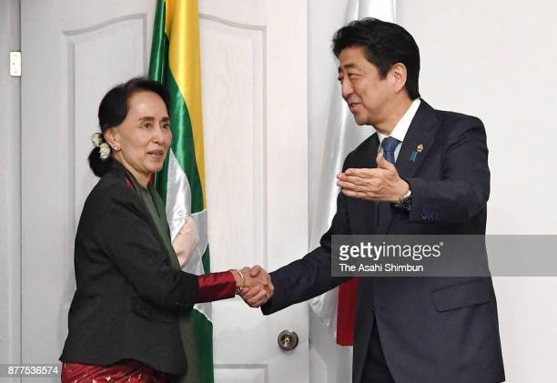 Japanese pm abe visits vietnam and philippines day 6 stock photos myanmar state counsellor aung san suu kyi and japanese prime minister shinzo abe shake hands during m4hsunfo